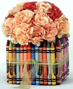 not a fan of the flowers used, but the crayons make a cute and inexpensive wedding or party centerpiece.