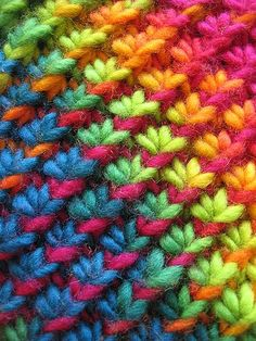 This is a neat #crocheted scarf pattern with a detailed stitch. The rainbow pattern is really fun to look at.