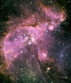 Star-forming region in space, located 210,000 light-years away in the Small Magellanic Cloud (SMC), a satellite galaxy of our Milky Way. At the centre of the region is a brilliant star cluster called NGC 346.