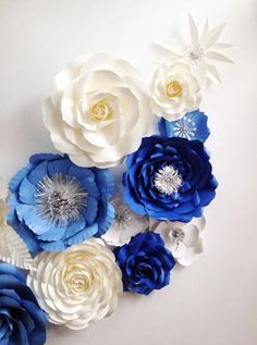 Blue Paper flower Backdrop one set of blue flowers with white off ivory silver in the middle of some flowers The size of big flowers are about 12 inch or 30 cm. the middle size is about 20 cm and small size is about 15 cm You may not need to full the whole backdrop with flowers but