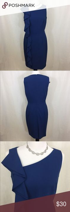 Beautiful Calvin Klein dress  Beautiful  Calvin Klein dress. Gorgeous ruffle detailing and asymmetrical neck line. Has a small line of demarcation on the bottom left. It's very faint and not noticeable. No other marks, stains or flaws. Size 8. Back zipper. Does have small belt loops(no belt included). FIRM price. Calvin Klein Dresses