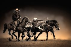 A composite image. I masked out a distracting background and added another to isolate the cowboys.