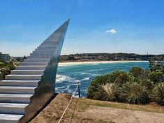 'Diminish and Ascend' is one of the sculptures exhibited at the annual exhibition Sculpture By The Sea, Bondi, Australia. The angle of the photo, creates an optical illusion that makes one think of an endless stairway to heaven.