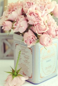 Excellent idea for reusing our tea tins and incorporating our love of tea into the wedding!