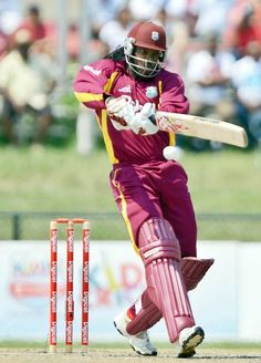 West Indies cricketer Chris Gayle plays a shot during the first T20 match between West Indies and New Zealand at the Central Broward Regional Park Stadium Turf Ground in Lauderhill, Florida.