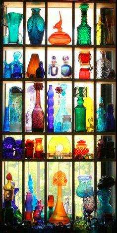 Cheap Home Decor Such a beautiful collection of vintage colored glass.Cheap Home Decor Such a beautiful collection of vintage colored glass. Colored Glass Bottles, Bottles And Jars, Perfume Bottles, Coloured Glass, Colored Vases, Deco Boheme, Displaying Collections, Deco Design, Glass Shelves