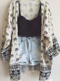 black crop top, blue shorts and white and dark blue elephant kimono cardigan.