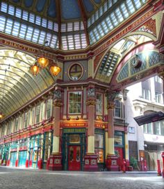 Leadenhall Market, a covered market on Gracechurch Street, London, England.     The succulent green, maroon, and cream coloured roof paired with the cobbled floors was designed in 1881; although the market itself dates to the 14th century, its site enthroned upon the ancient centre of Roman London. The Market was the filming site for Diagon Alley in the cinematic adaptation of Harry Potter And The Philosopher's Stone/Harry Potter And The Sorcerer's Stone      image by selzerz on fli