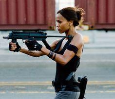 Hot Chick With Weapons: Zoe Saldana Wields A Submachine Gun  http://www.starpulse.com/news/index.php/2010/04/08/hot_chick_with_weapons_zoe_saldana_wie