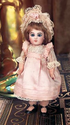 """*FRENCH BISQUE BEBE E.J., SIZE 2, W/DRAMATIC EYES ~ 10""""t. Bisque socket head, blue glass paperweight inset eyes...MARKS: Depose E 2 J (head,+ artist check marks) Jumeau Medaille dOOr Paris (body). COMMENTS: Emile Jumeau, circa, 1884."""