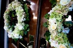Looking for a little more than just centerpieces and bouquets? Lee James Floral Design can create stunning arrangements of all shapes and sizes. We love these color neutral wreaths from Shelby and John's wedding.