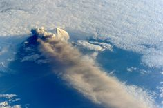 Astronauts aboard the International Space Station (ISS) photographed these striking views of Pavlof Volcano on May 18, 2013. The oblique perspective from the ISS reveals the three dimensional structure of the ash plume, which is often obscured by the top-down view of most remote sensing satellites.