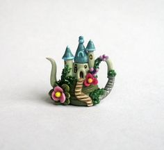 This miniature whimsy fairy castle teapot is a one of a kind original design and creation by artist C. Rohal. It is completely hand made.