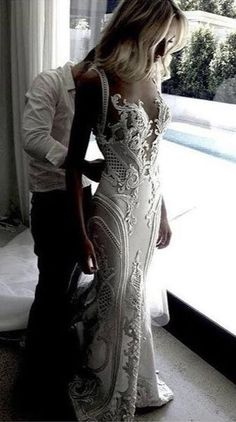 Ornate & couture wedding dresses like this may seem out of your price range. But our USA based design company can easily make a replica of any couture bridal gown for you. It will be similar or close to the original but a fraction of the couture cost. Get pricing on your favorite #weddingdresses when you email us from our website at www.dariuscordell.com