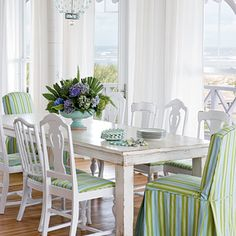 mismatched chairs, all painted white and upholstered with the same fabric.mismatched chairs, all painted white and upholstered with the same fabric. Pine Dining Table, Dining Room Table, Table And Chairs, Side Chairs, Rustic Table, Farmhouse Table, Dining Area, Dining Sets, Dining Rooms