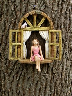 This miniature widow with little sitting girl will be a lovely addition to your fairy garden or miniature garden. It can be hung from a tree
