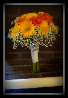 Hand-tied Bouquet: Yellow Gerbera Daisies, orange spray roses and baby's breath #1. by Rose of Sharon Floral Designs, via Flickr