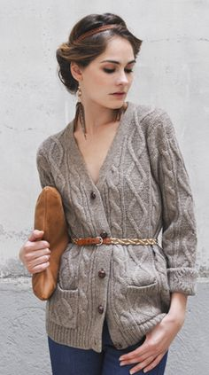 i like how the braided belt is worn over the thick cardigan, adding a little detail of interest