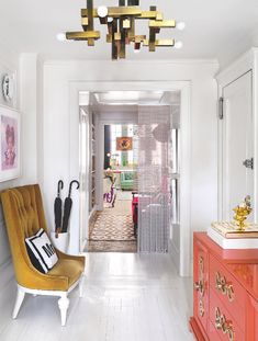 The striking modern white walls allow for Jonathan Adler's playful twists to take centre stage! From the velvet upholstered bench to the orange lacquer cabinet it brings lively contemporary colour to a simple hallway scheme. Image: Livingetc Home Design, Lounge, Upholstered Furniture, Modern Room, Entryway Decor, Modern Entryway, Entry Foyer, Interior Design Inspiration, Design Ideas