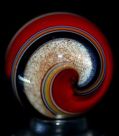 """Red Art-Glass Marble with Multi Colored Swirls inc.a striking band of Black, a wide Band of White & shimmering Aventurine Glass adding extra pizazz! It is signed Bad Dog, circa 2008, and just under an inch at .877""""   Marble is from the """"WALD Glass Art Studio"""" of Rolf & Genie Wald         eBay♥≻★≺♥"""