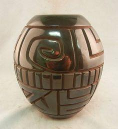 Stunning gunmetal finished, deeply carved pot by #SantaClara Harrison Begay