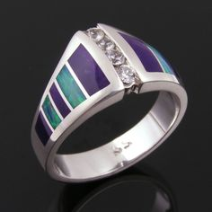 Australian opal and purple sugilite inlay sterling silver ring. The deep purple sugilite is separated by bright blue-green Australian opal on each side of the ring. Four sparkling white sapphires are