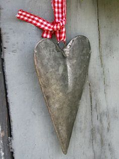 Tin heart with gingham ribbon.