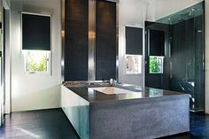 Now that is a great polished concrete bath surround, wonderful contemporary bathroom