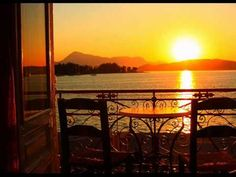 Sunset view from a balcony in Poros island, Saronic Gulf_ Greece Beautiful Forest, Beautiful Sunset, Greece Resorts, Sun Music, Greek Culture, Greek Music, Image Of The Day, Best Western, Archaeological Site