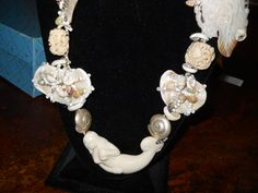This is a mermaid necklace I made with a carved bone mermaid focal bead, real shells, Thai silver and an abalone jelly fish bead. There is a picture of the whole piece on my Searching For Mermaids board. I wear it with black.