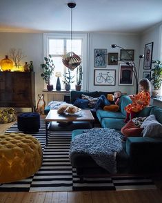 Image may contain: 1 person, sitting, living room, table and indoor home in Living Room Sofa, Living Room Interior, Home Design, Home Interior Design, Salons Cosy, Living Room Decor Inspiration, Deco Boheme, Home And Living, Small Living