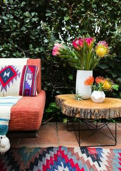 Love the flowers, the vases, the trunk slab, the chair and the tribal pillow.. Love it all