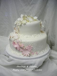 Ombre cascade of flowers and butterflies with hand-piped scrollwork detail