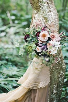 Gold Aje Liberty wedding dress and bouquet | Lara Hotz Photography for Hooray Magazine with styling by Stefanie Ingram, beauty by Liv Lundelus Makeup Artist and floral design by Jardine Botanic Floral Styling