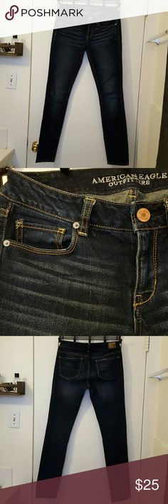 American Eagle Skinny Stretch Jeans Dark blue  Skinny stretch Not ankle skinny Has lighter stripes on pockets *make an offer* American Eagle Outfitters Jeans