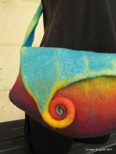 felt bag by Pam deGroot on Etsy - love the color and swirl closure