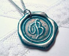Ritzy Misfit Wax Seal Pendant - $38. Do I like this more in teal (about the size of a quarter) or solid copper (about the size of a dime)? Decisions, decisions... :)