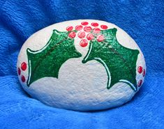 This listing is for a holly jolly Christmas painted rock! The holly is painted with a glitter finish. The edge is lined with rose gold dots.  ****************************************************************  Kindness Rocks! If you havent heard of the movement that is sweeping the