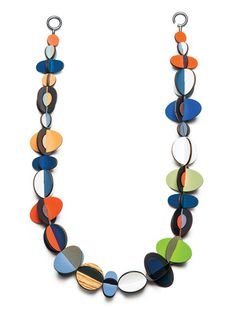 Nice photo of a Rebecca Hannon Laminate series where she chooses not to close the necklace but lays it out in a formal U shape.