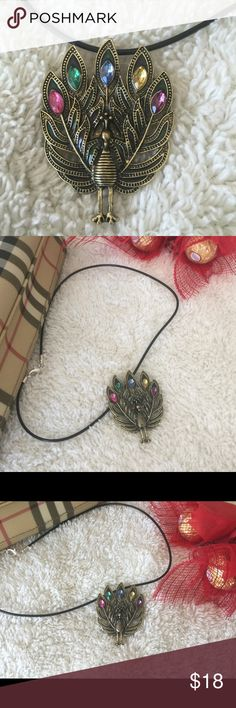 Peacock Pendant with necklace Nickel free. Necklace is a lobster lock. It has 5 different stones, pink, green, blue, yellow & purple. Necklace measures 18 inches & pendant measures 2 inches all across. You can also use the pendant as a brooch. Personally handmade by yours truly. 🔷Price firm unless bundled🔷NWOT🔷 Handmade by Charm Jewelry Necklaces
