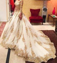 Majestic golden and cream bridal lehenga..