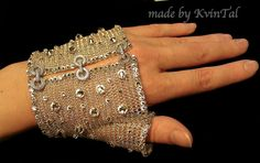 Thank you for visiting my shop!  Delicate and stunning accesory for your special occasion. Mesh glove handmade out of high quality silver plated wire . Source Etsy By Kvin Tal , owner Oksana Thomas
