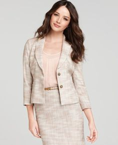 Tweed Suit. Very feminine and soft spoken. Nice peach and coral combination with blouse and makeup. Skinny belt in amber colored leather finishes it off.