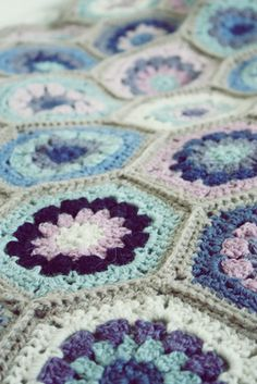 : crocheting detailed, colorful blankets, amongst other crocheting projects (like the edges on burp cloths)