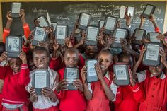 Some very happy children in Africa receiving free Kindles as part of the www.worldreader.org project to improve literacy