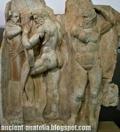 Heracles & Antaios - Ancient Oil Wresting  ..  Heracles is preparing to wrestle the Libyan giant Antaios. Herakles (left) is taking off his bow-case to hang it on a rustic pillar-statue. Antaios (right) is binding up his head with ear-protectors; next to him stands an oil basin as used in the wresting ground, palaistra. Antaios was a famous wrestler and challenged and killed all visitors to his country, until defeated by Herakles. - Museum of Aphrodisias, Turkey.