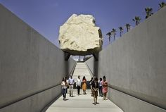 Levitated Mass by Michael Heizer.    It's a sculpture at the LA County Museum of Art. The 340 ton boulder is one of the largest megaliths moved since ancient times.