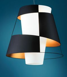 Crinolina suspension light in powdercoated steel with cotton-resin lampshade and diffuser in anthracite gray and gold painted PVC by Lepere, 212-488-7000; lepereinc.com.