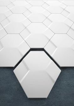 Turkish designer Yigit Ozer has created a range of three dimensional wall tiles for ceramic company Kutahya Seramik. Called Nexus, the range of hexagonal tiles are cast with two relief designs: Penta comprises four pentagons and Hexa comprises two hexagons and two diamonds. The two types can be laid horizontally, vertically or in combinations to produce a variety of honeycomb patterns.