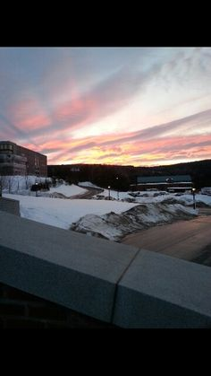 Sunset over the Vermont National Guard to the right, and West Hall to the top left